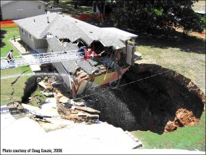 House Falling into Sinkhole